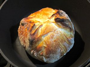 dutch oven baking loaf of bread